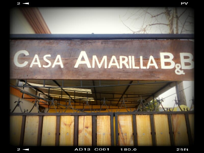 Photos of billboard in hostal casa amarilla ecopackers for Hostal casa amarilla