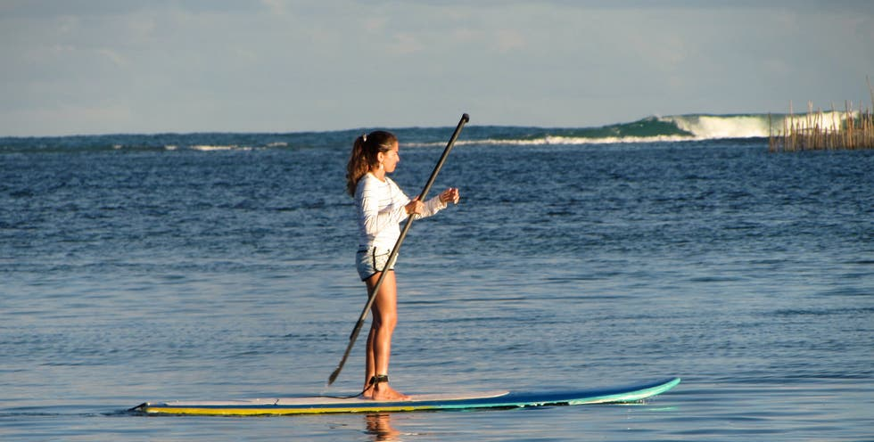 Stand up paddle surfing a Maceio